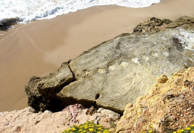Dinosaur footprints on Salema beach